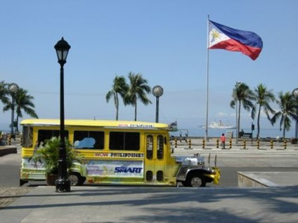 A jeepney & Philippine flag at Roxas Boulevard in Manila - from Carol's camera (December 2006-January 2007)