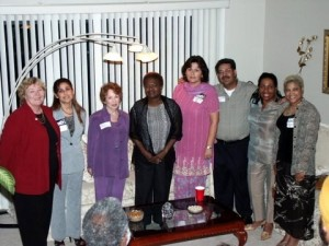 Mohinder Mann and his wife, Robina Mann (to his right), have a photo with community advocate-friends
